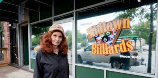 Maggie Hinson standing in front of her bar, Midtown Billiards
