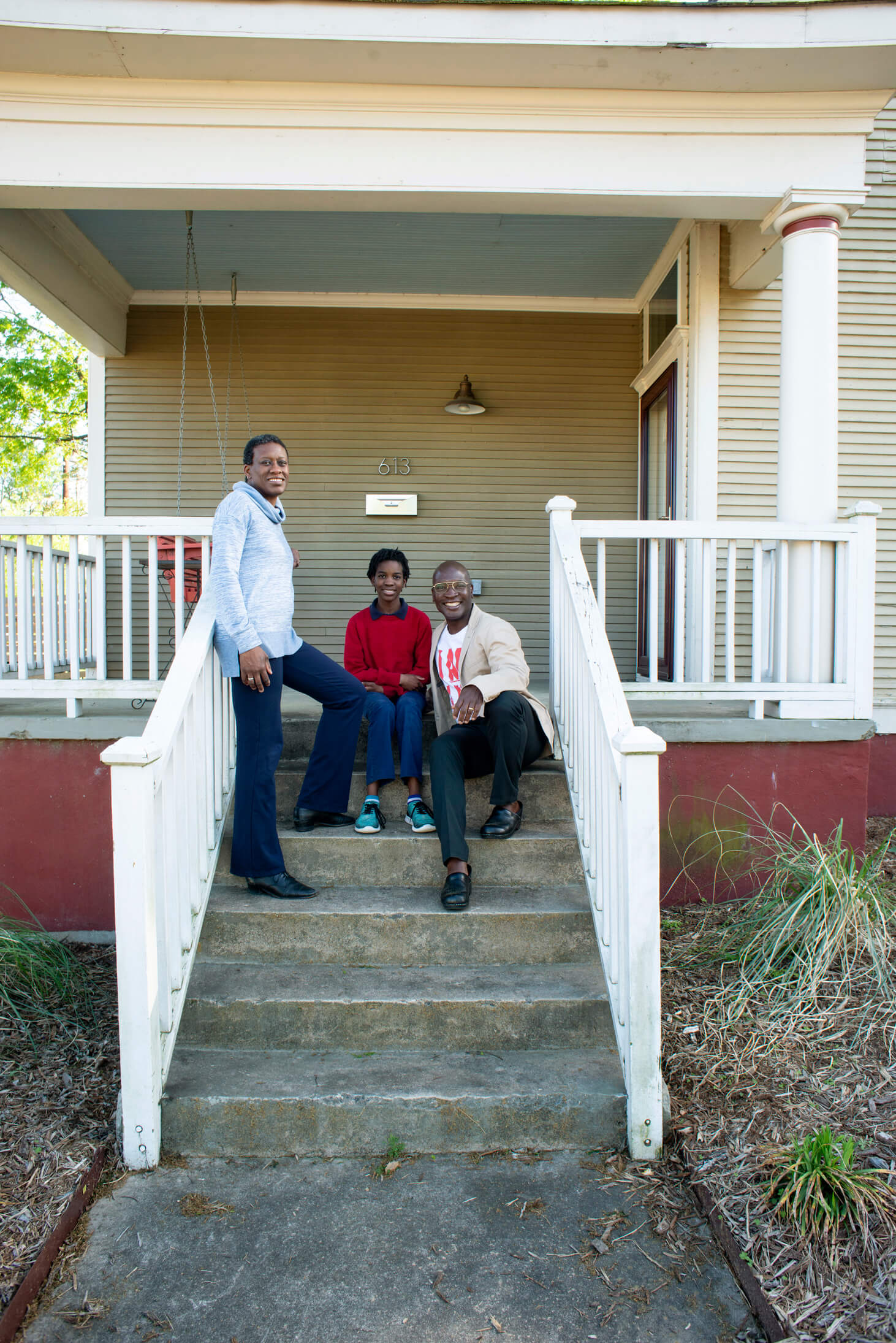 Karama Neal and Kwadjo Boiatey and their daughter, Ayoka, in front of their Pettaway home