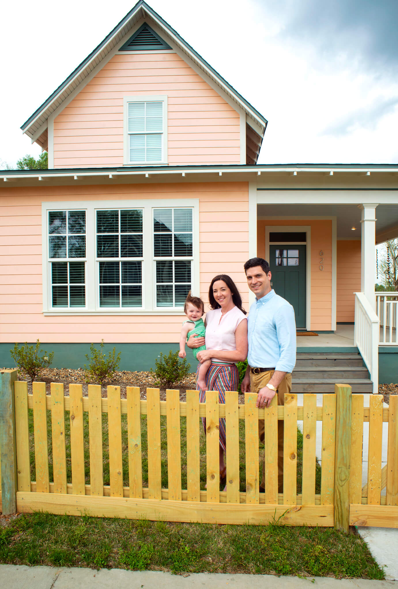 Adam and Jill Fogelman with their son, Jude, in front of their Pettaway house image