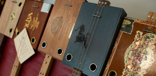 Pictures of Flying Pig cigar box guitars