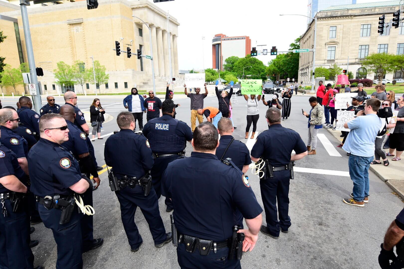 Little Rock Police stand in front of protestors demanding justice for Bradley Blackshire