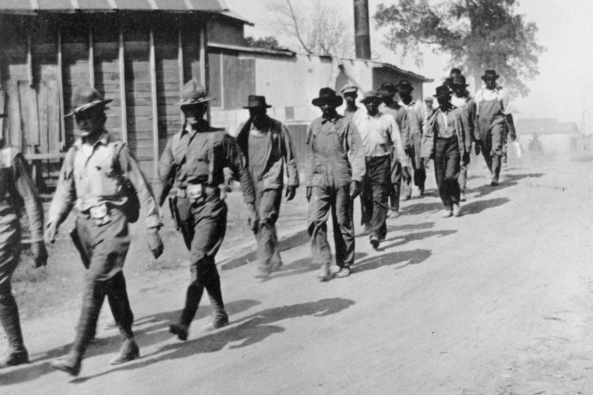 Soldiers from Camp Pike lead black men into Elaine in 1919.